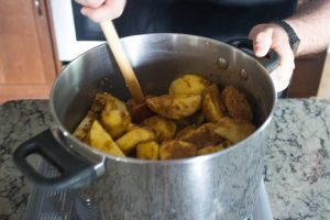 Place everything into a pot and stir everything to combine. Cook covered over medium low heat for about 2 hours, or until the apples have gotten nice and soft. Cover and refrigerate until everything has cooled down. This allows the softened apples to absorb the liquid in the pot.