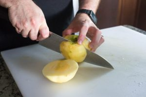 Once you've peeled all of your apples, cut the meat from the core.