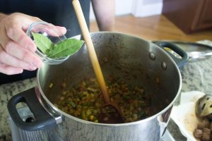 Add bay leaves, cook uncovering to stir occasionally, about 15 minutes.