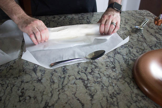 place half of the dough on a piece of parchment paper. form into a cylinder and twist the ends to make it more uniform. Refrigerate for 2 hours.