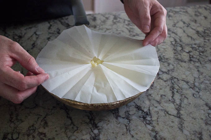 Cover with your parchment round and press down.