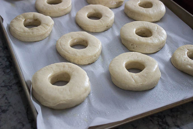 Using the parchment, turn the doughnuts over into your hand one at a time. Fry at 350F in batches for 80 seconds per side. There should be a beautiful blonde band in the middle between the two golden outsides.