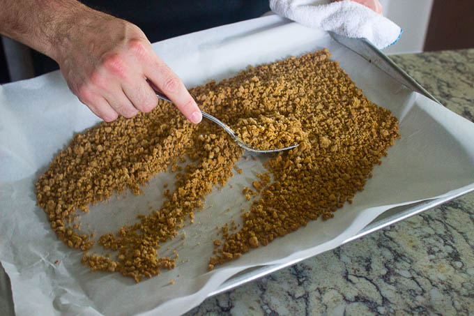 Bake the mixture for 18 minutes, rotating the pan and stirring every 5 minutes, keeping the streusel spread out evenly. All of this ensures a nice, consistent bake. When done, let the streusel cool on the sheet tray until it comes to room temperature.