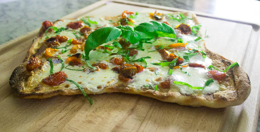 I prefer to grill my flat breads as it gives a nice crisp bottom, as well as a beautiful smokiness. If grilling, make sure you add your toppings after grilling one side and flipping it.