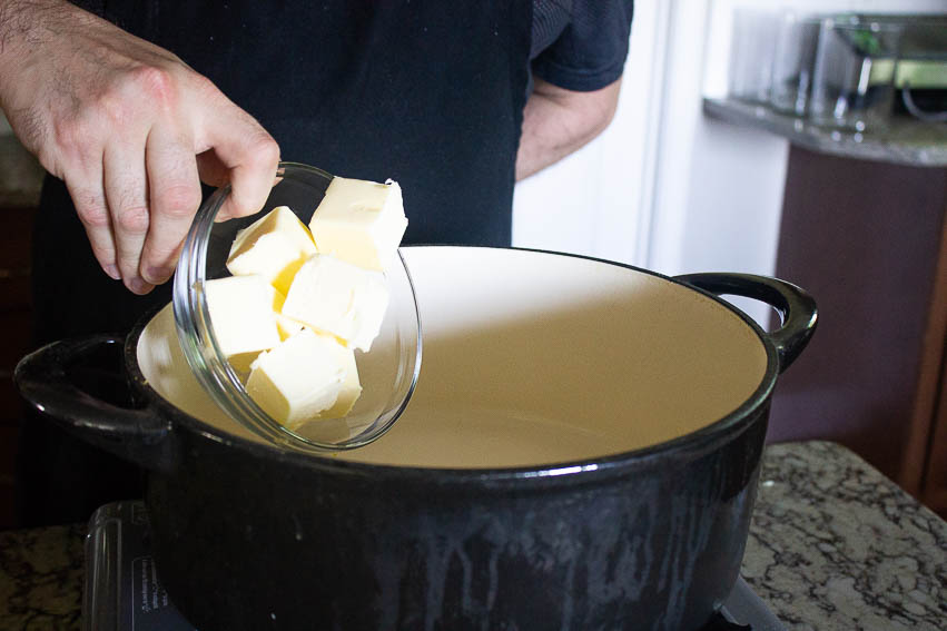 Melt your butter in the pan and stir in your flour. Over medium low heat, keep stirring your roux cooking the flour.